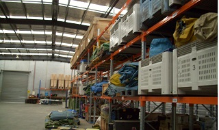 Racks filled with Camping Gear in large warehouse