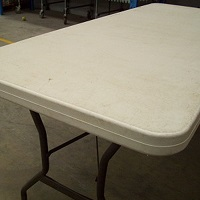 Plastic top fplding table for hire