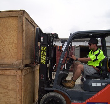 Forklift with full wooden crates