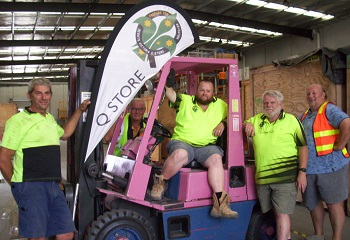 Q store team and the fork lift