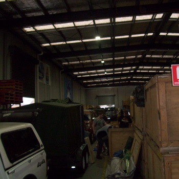 Trailers and crates lined up inside Q store